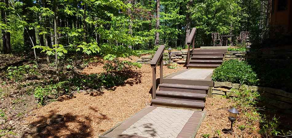 Cedar mulch has been installed on either side of the stairway of this Saginaw property.