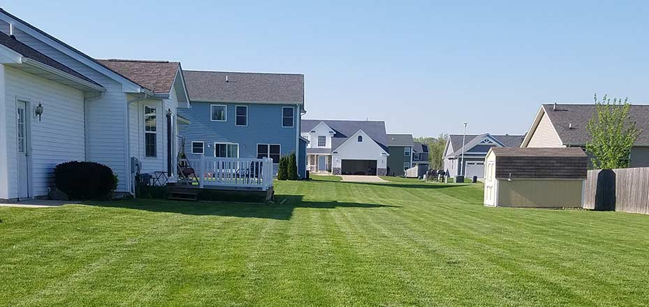 Scheduled lawn mowing was done for this Saginaw, MI homeowner's yard.