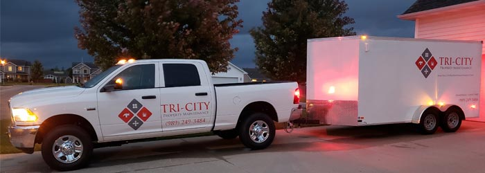 Tri-City Property Maintenance truck and trailer.